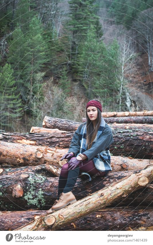 Young woman on wood logs Woman Nature Beautiful Tree Relaxation Loneliness Girl Forest Adults Autumn Lifestyle Hiking Action Beauty Photography Behind Caucasian
