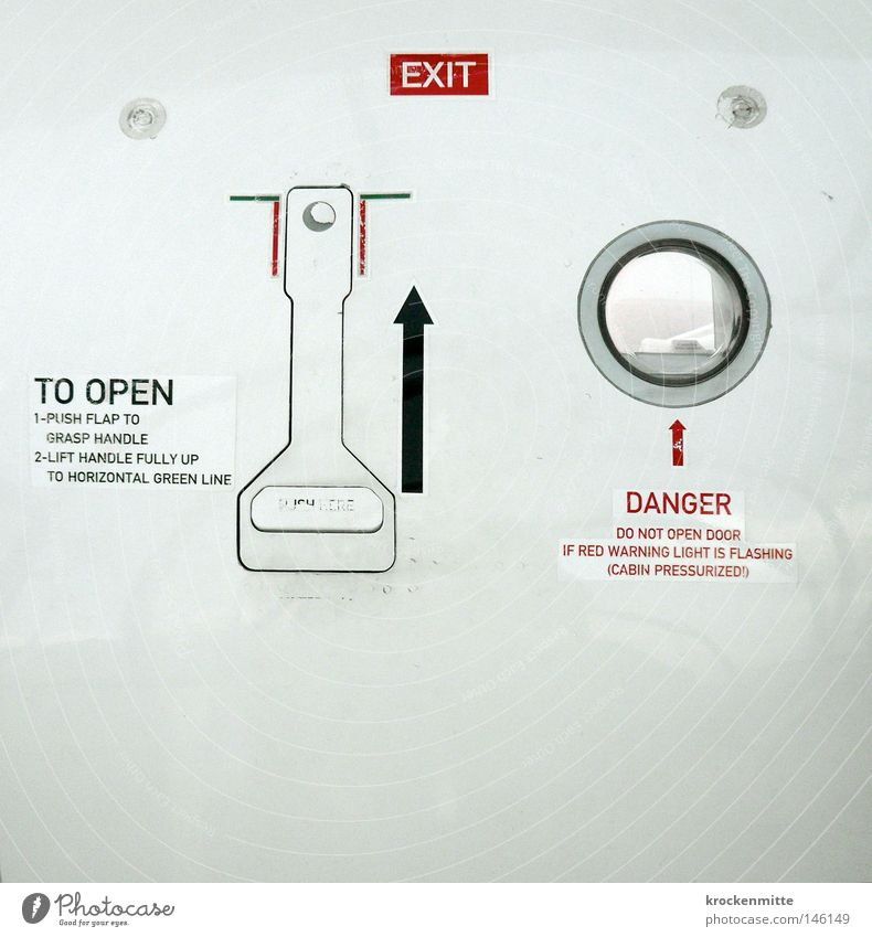 E X I T Airplane Way out Dangerous Circle Window Lever Red White Undo Emergency exit Flying Vacation & Travel Travel photography Fear Arrow Black