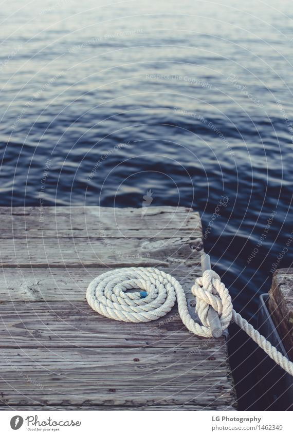 Dock - White Coiled Rope Relaxation Watercraft Tie Dark Safety attached boating Body of water cleat coil coiled Deep dock edge float Floating knots lines looped