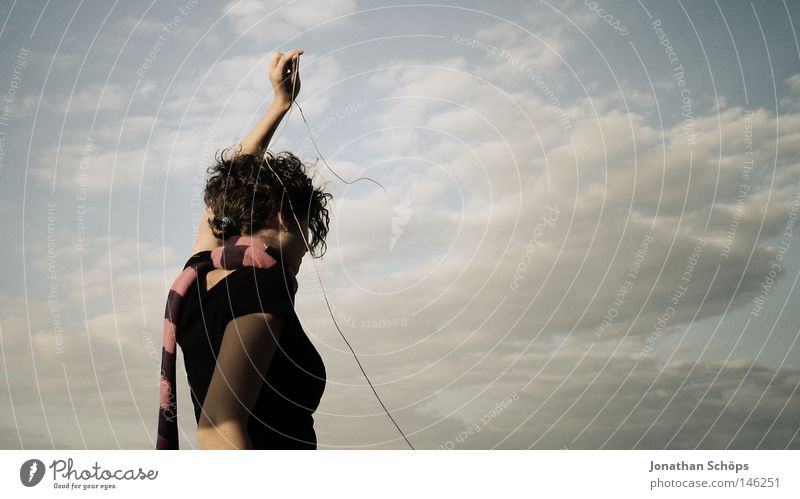 young woman in black and scarf in front of cloudy sky with string Contentment Calm Rope Human being Feminine Young woman Youth (Young adults) Back 1