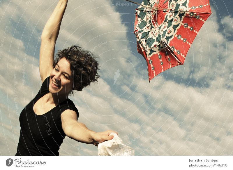 young woman with red umbrella stretches her arms in the blue sky for joy Joy luck Hair and hairstyles Contentment Far-off places Success Human being Feminine
