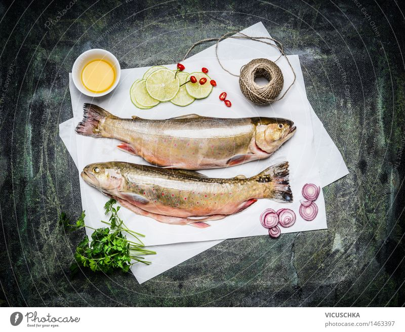 Raw fish on white paper with ingredients for cooking Food Fish Herbs and spices Cooking oil Nutrition Lunch Dinner Banquet Organic produce Vegetarian diet Diet