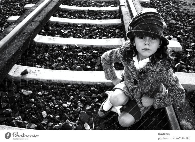 Stone Anger Railroad tracks Hat Train station Coat Aggravation Illogical