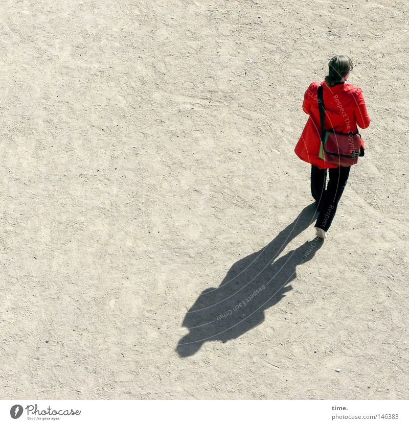 HH08.3 - Red jacket on a stalk Trip Feminine Woman Adults Back Places Traffic infrastructure Clothing Bag Going Sand place In transit Sunlight Individual
