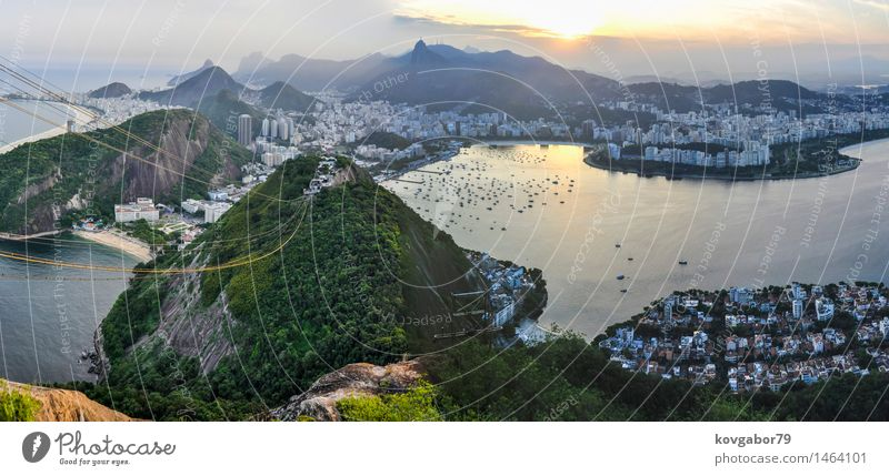 Panoramic view of Rio de Janeiro at sunset, Brazil Beautiful Vacation & Travel Beach Ocean Landscape Town Skyline Aircraft Sunset Vantage point america christ