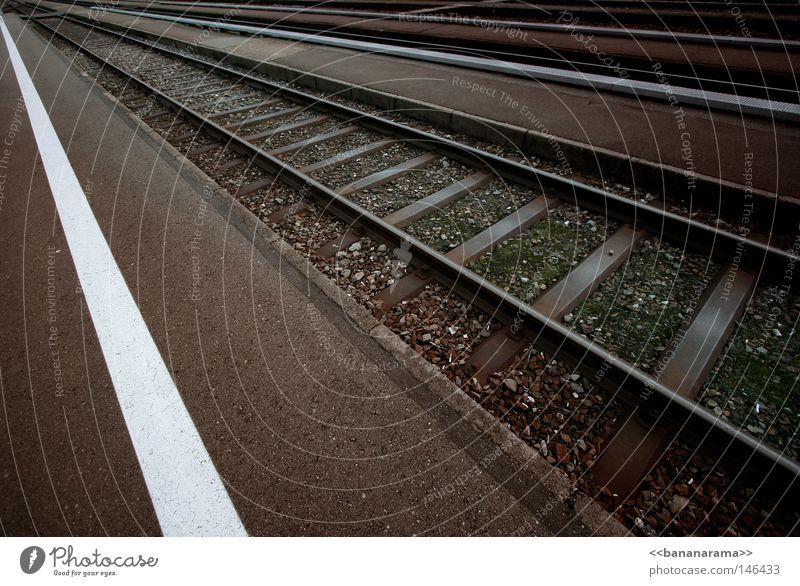 on the run Railroad Commuter trains Railroad tracks Vanishing point Far-off places Infinity Driving Transport Vacation & Travel Switzerland Gravel