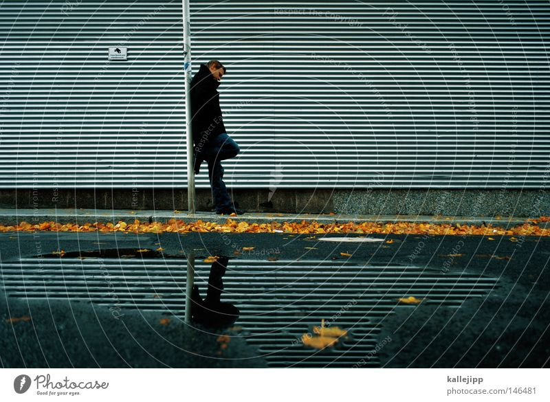 Human being Man Water Vacation & Travel Leaf Yellow Cold Work and employment Autumn Sadness Wait Stand Safety Gloomy Stripe Grief
