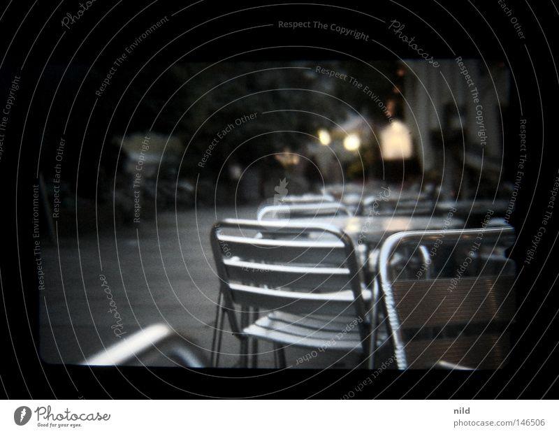 Analog Digital - Street Café Empty Autumn Cold Evening Munich Sidewalk café Table Chair Calm Comfortless Pedestrian Viewfinder Blur Traffic infrastructure