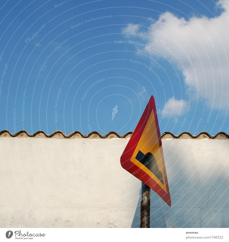Sky Clouds Wall (building) Signs and labeling Dangerous Warning label Caution Blue sky Road sign Warning sign Traffic lane Undulation Warning colour Elevation