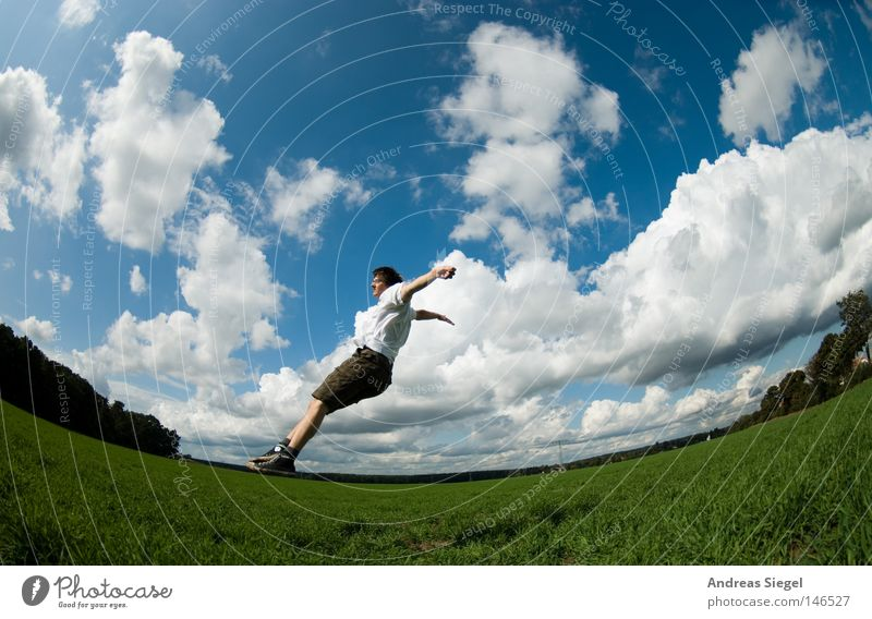 Human being Sky Man Youth (Young adults) Blue Green Summer Clouds Meadow Freedom Jump Horizon Field Flying Aviation
