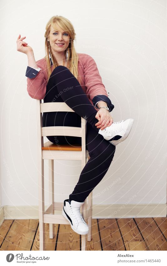 interview Style Beautiful Athletic Well-being Contentment Room Floorboards Young woman Youth (Young adults) Body 18 - 30 years Adults Leggings Sweater Sneakers