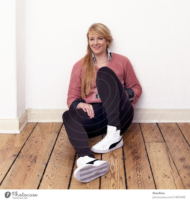 Full body portrait of a young woman in sneakers sitting on a plank floor Flat (apartment) Room Floorboards Young woman Youth (Young adults) Body 18 - 30 years