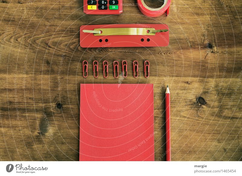 Red writing utensils, paper, notes, pencil, paper clips, staple, adhesive tape, calculator on a wooden desk Study Work and employment Profession Workplace