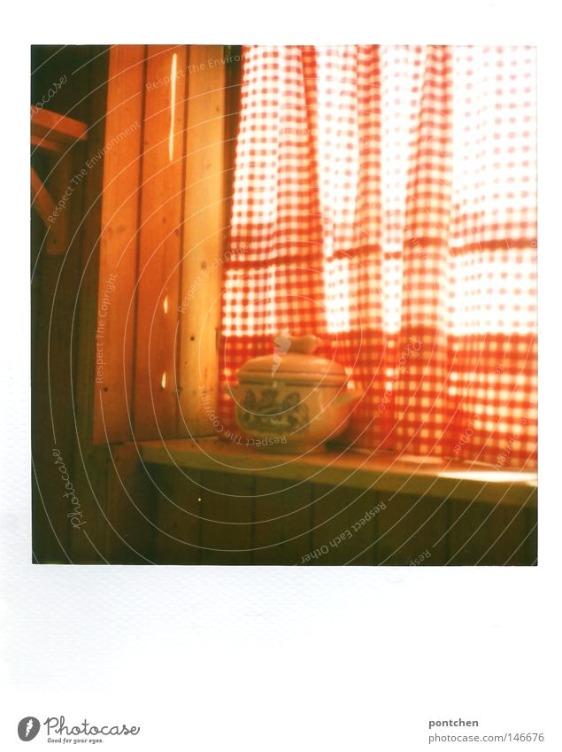 Bavarian Weißwursttopf stands on a windowsill in front of a red and white curtain. Kitsch, tradition, customs Polaroid Light Nutrition Bowl Pot Sun