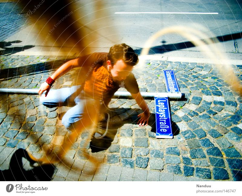 Stormy times Gale Street Signs and labeling Street sign Human being Man Youth (Young adults) Youth culture Multicoloured Strand of hair Wind Whimsical Strange