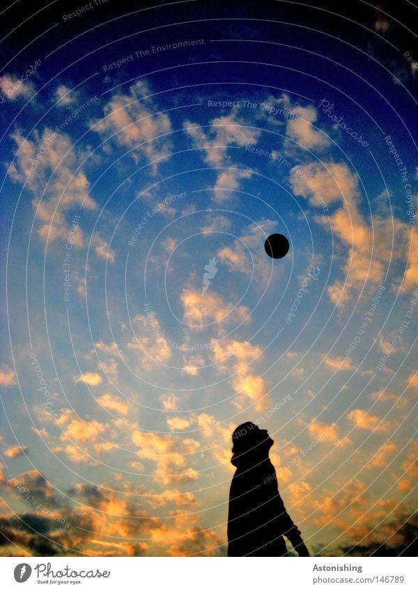 Human being Sky Man Blue Sun Clouds Black Yellow Dark Orange Soccer Tall Foot ball Ball Sphere Upward