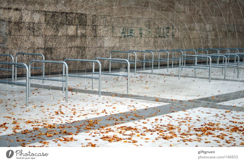 City Leaf Loneliness Autumn Graffiti Wall (barrier) Transport Characters Empty To fall Traffic infrastructure Parking lot Mural painting Bicycle rack