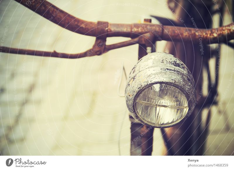 Retro bicycle lamp Bicycle Metal Rust Brown Nostalgia Bicycle handlebars Bicycle light Old Exterior shot Deserted Copy Space left Day Colour photo Detail
