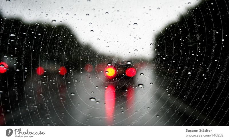 Car Rain Weather Motor vehicle Highway Illuminate Traffic infrastructure Smoothness Brakes Windscreen