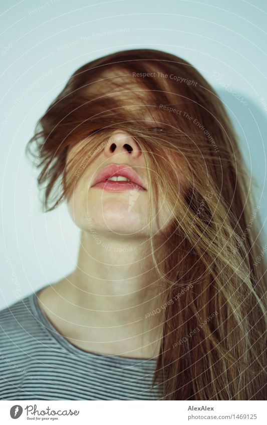 Portrait of a dark blond, long-haired woman looking into the camera through the hair on her face Lifestyle Style pretty Young woman Youth (Young adults)
