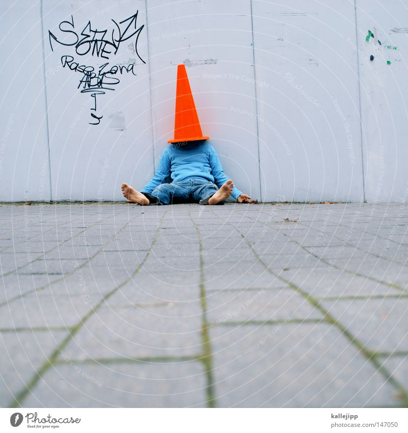 from the socks Man Human being Mushroom cap Headwear Red Construction site Hat Playing Barefoot Wall (building) Crash barrier Transport Town Whimsical Crazy