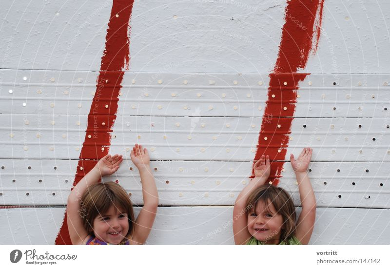 Human being Child Hand Girl White Red Joy Face Wall (building) Playing Laughter Hair and hairstyles Head Friendship Line Signs and labeling