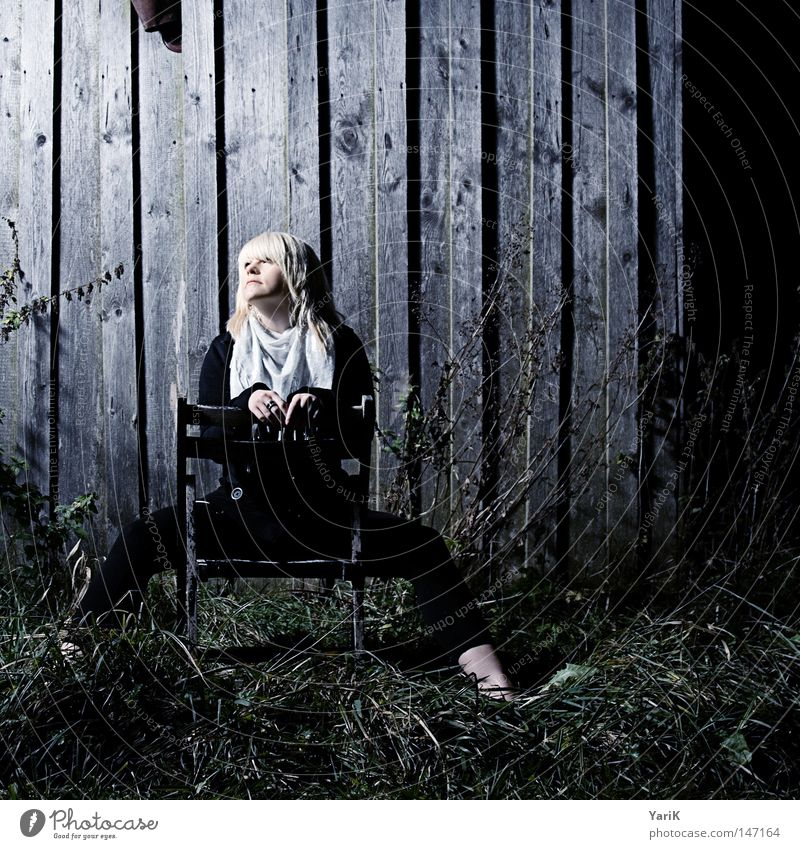 dark spot Woman Wall (building) Wall (barrier) Barn Wood Wooden board Cold Night Evening Dark Loneliness Photo shoot Portrait photograph Posture Light