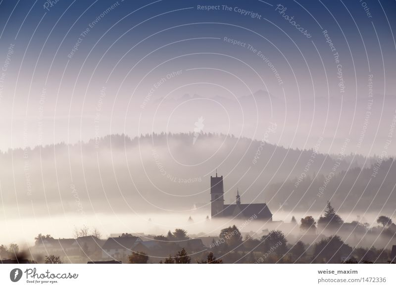Foggy morning in small town. Church in a mist. Vacation & Travel Blue White Tree House (Residential Structure) Forest Mountain Autumn Meadow Building Tourism