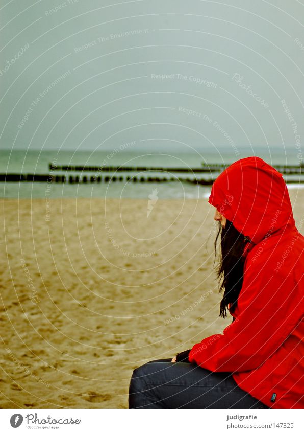 Red on the beach Beach Human being Woman Rain jacket Autumn Sand Coast Ocean Vacation & Travel Relaxation Cold Loneliness Think Hair and hairstyles Scarf