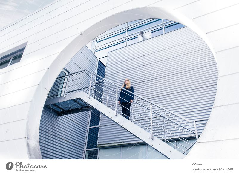 Woman in architecture Feminine 1 Human being 18 - 30 years Youth (Young adults) Adults Industrial plant Manmade structures Architecture Stairs Coat Blonde