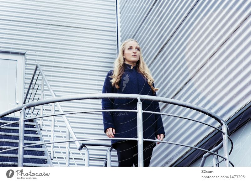 titanic Feminine 1 Human being 18 - 30 years Youth (Young adults) Adults Manmade structures Building Architecture Stairs Coat Blonde Long-haired Stand Wait
