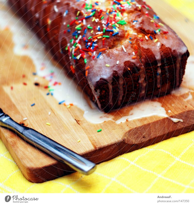 bake a cake Cake Kitchen Knives Table-knife Wooden board Chopping board Overlaid Chocolate coating Sugar Granules Sweet Icing Birthday Birthday cake Surprise