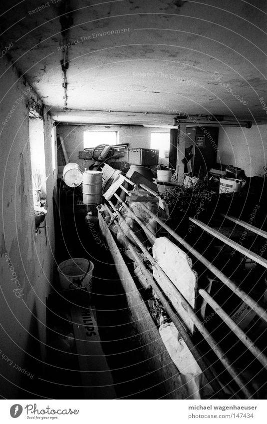 Old Dark Window Empty Trash Barn Shaft of light Black & white photo Masonry Barricaded Metal post