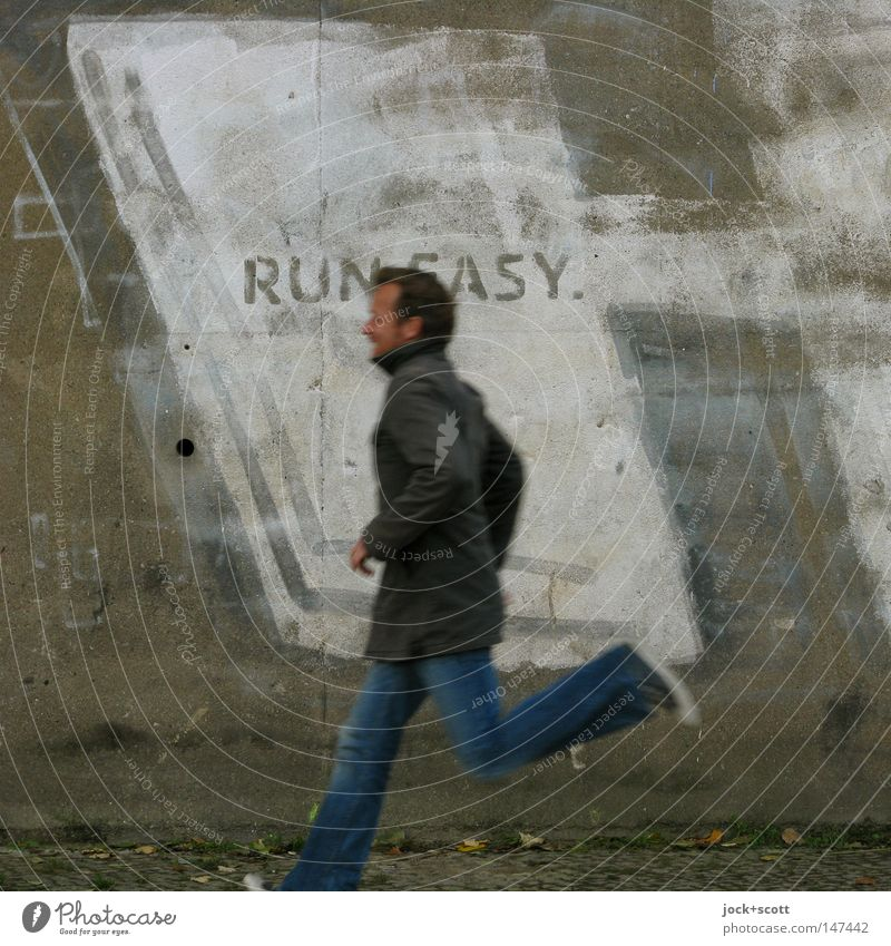 Human being Man Young man Adults Wall (building) Graffiti Movement Wall (barrier) Gray Power Walking Characters Speed Concrete Force Simple