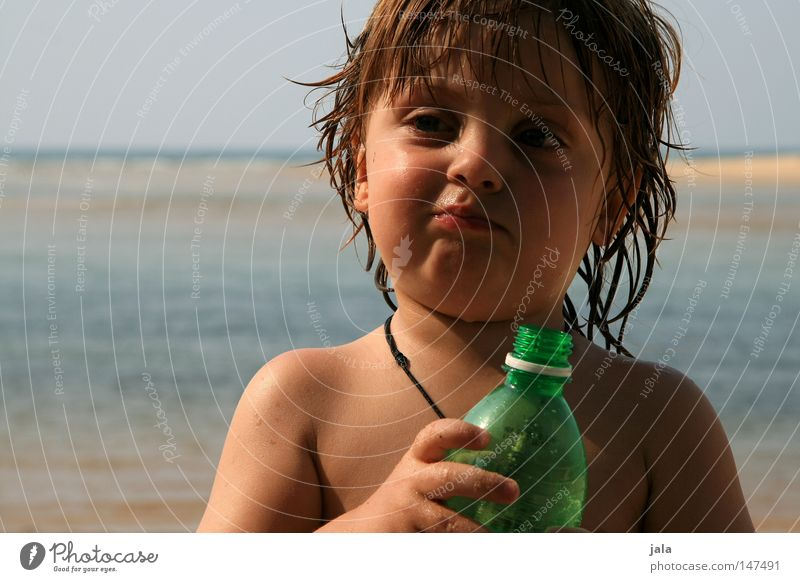 summer child Child Vacation & Travel Boy (child) Face Hand Water Ocean Beach Bottle Wet Facial expression Leather strip Shoulder Sand Sky Summer Skin