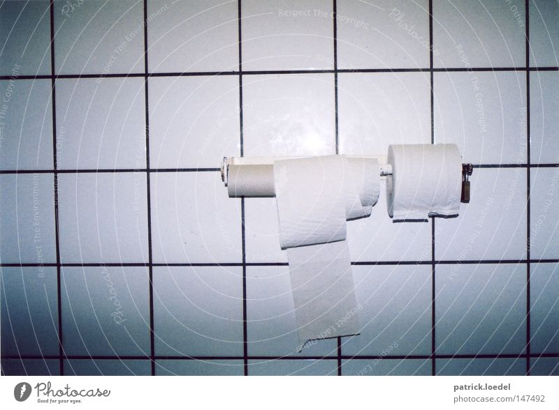 Stop toilet paper theft on public toilets Toilet Toilet paper Coil Tile Cardboard Castle Padlock Closed Store premises Gloomy White Paper Round Sharp-edged