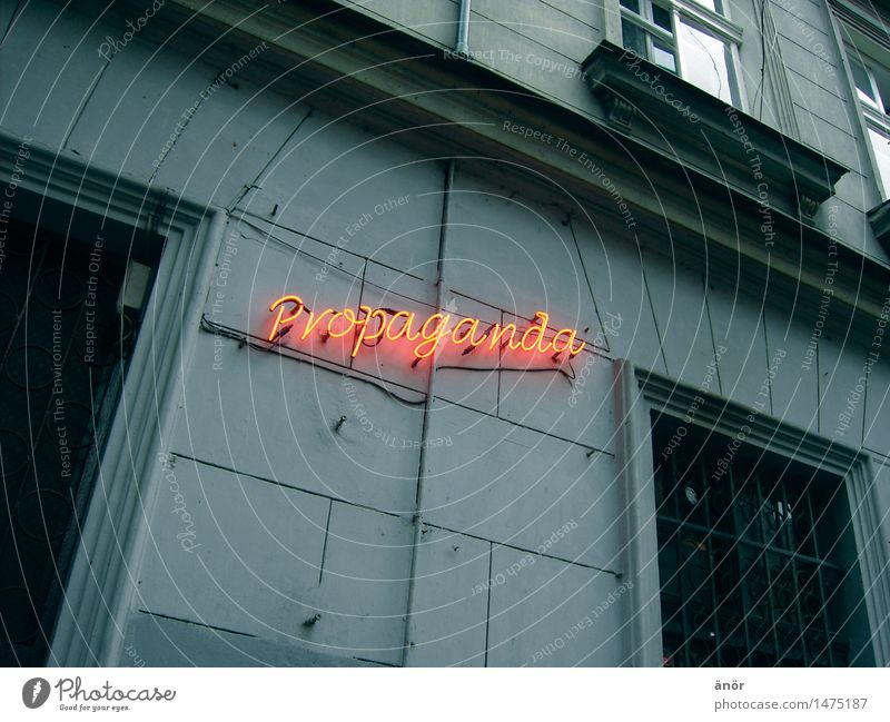 propagandized Town Downtown Old town Deserted Wall (barrier) Wall (building) Facade Window Decoration Concrete Characters Signs and labeling Reading Illuminate