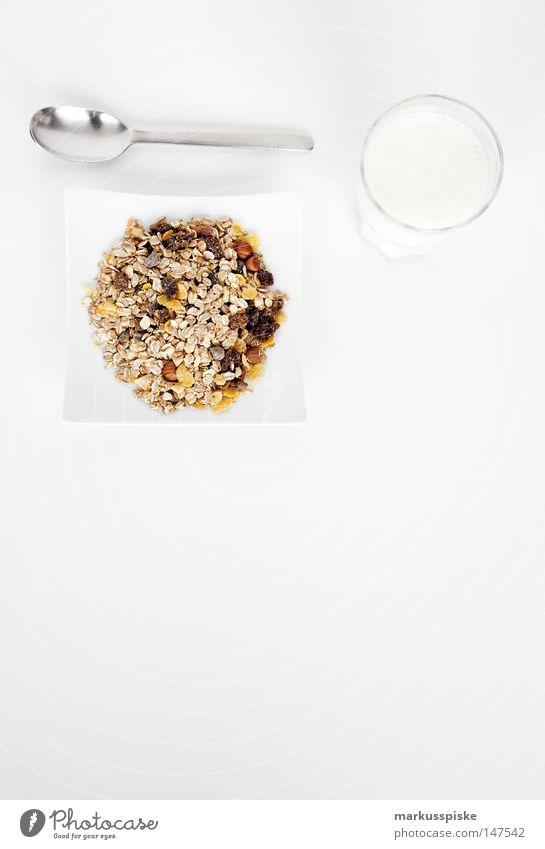 müsli with milk Breakfast Beverage Spoon Milk Plate Healthy Nutrition Grain Raisins Oat flakes Wheat Rye Oats Hazelnut Raw vegetables Whole foods