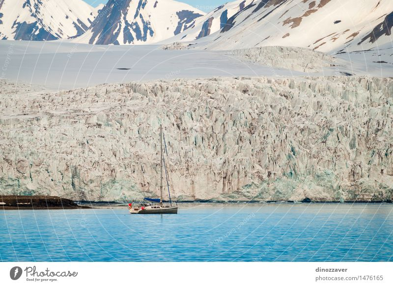 Sailing boat at the glacier Vacation & Travel Ocean Winter Snow Mountain Environment Nature Landscape Climate Glacier Coast Sailboat Watercraft Freeze Blue