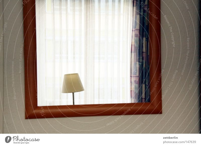 HOTEL Mirror Lamp Reading lamp Wall (building) Hotel Hotel room Reflection Picture frame Window Curtain Light Gloomy Loneliness Grief Detail Living or residing