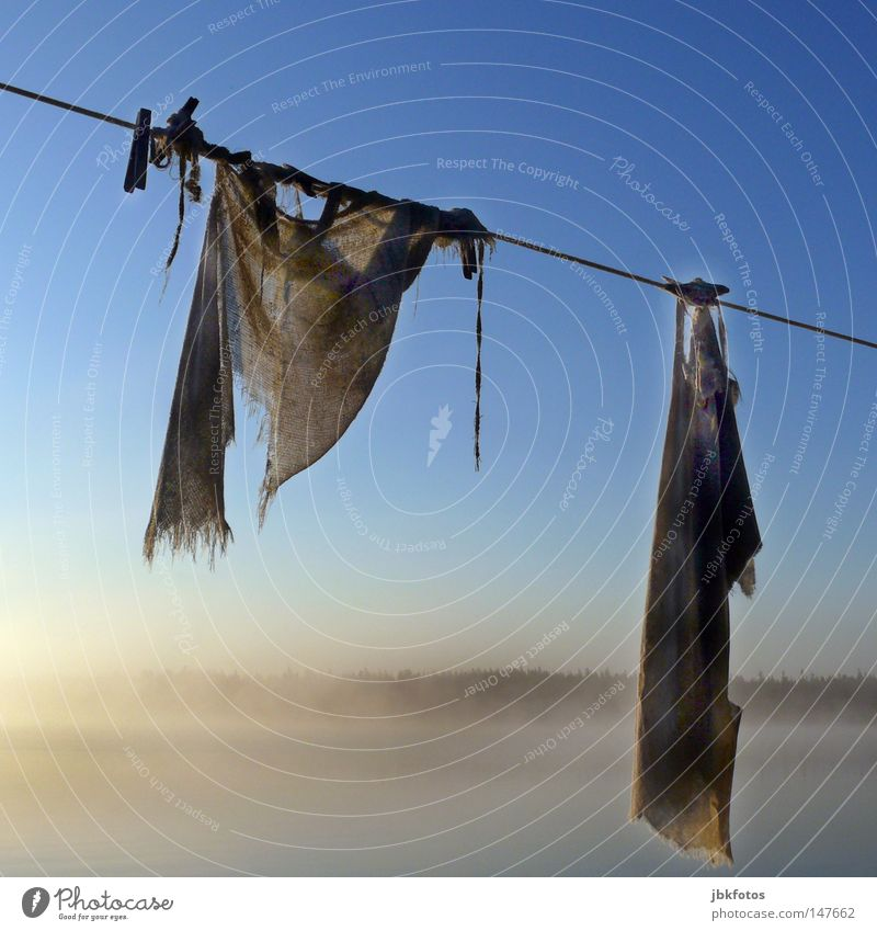left hanging Laundry Clothesline 2008 Nova Scotia Canada Hang Fog Morning Clothes peg Floor cloth Old Rope Sky Blue White Brown Square Derelict Jute Sack Forget
