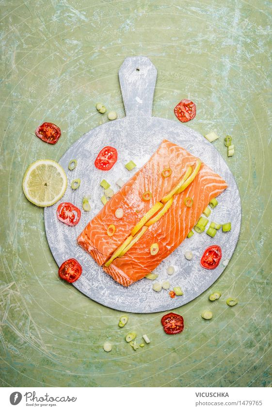 Fresh salmon fillet with lemon and cooking ingredients Food Fish Herbs and spices Nutrition Lunch Dinner Banquet Organic produce Vegetarian diet Diet Style
