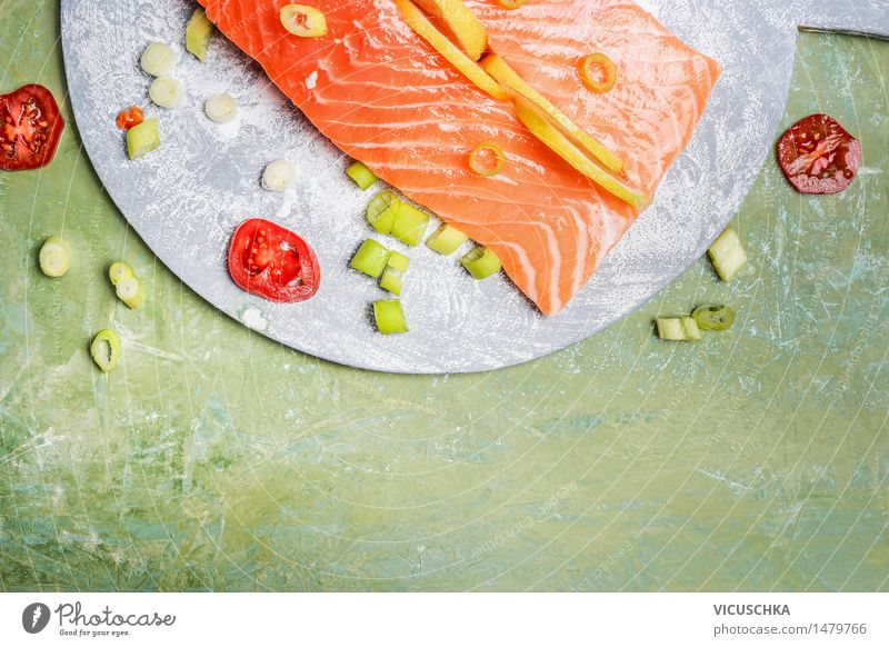 Salmon fillet with lemon and cooking ingredients Food Fish Herbs and spices Nutrition Lunch Dinner Buffet Brunch Banquet Organic produce Vegetarian diet Diet