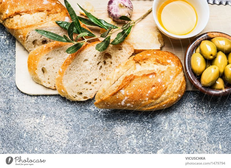 Baguette with olives, garlic and cheese Food Cheese Vegetable Herbs and spices Cooking oil Nutrition Lunch Dinner Organic produce Vegetarian diet Italian Food