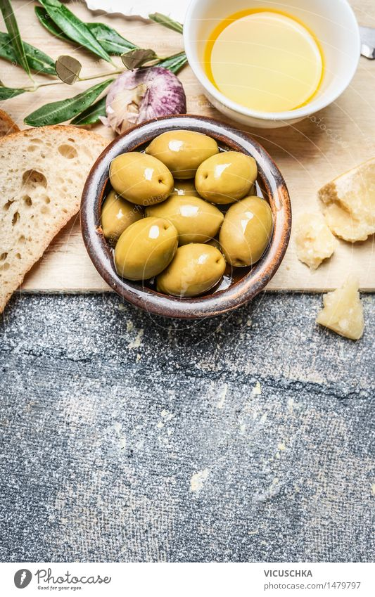 Olives in a bowl with baguette, oil and cheese Food Vegetable Bread Herbs and spices Cooking oil Nutrition Lunch Organic produce Vegetarian diet Diet