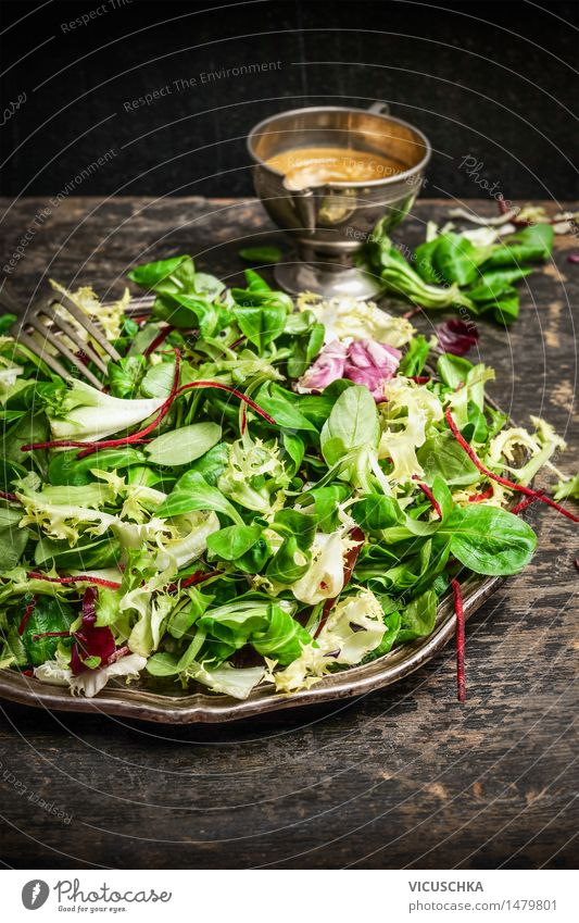 Healthy green salad with dressing on dark background Food Lettuce Salad Nutrition Lunch Organic produce Vegetarian diet Diet Italian Food Plate Style Design