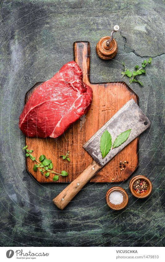 piece of beef on cutting board with butcher's hatchet Food Meat Herbs and spices Nutrition Lunch Dinner Banquet Organic produce Knives Healthy Eating Table