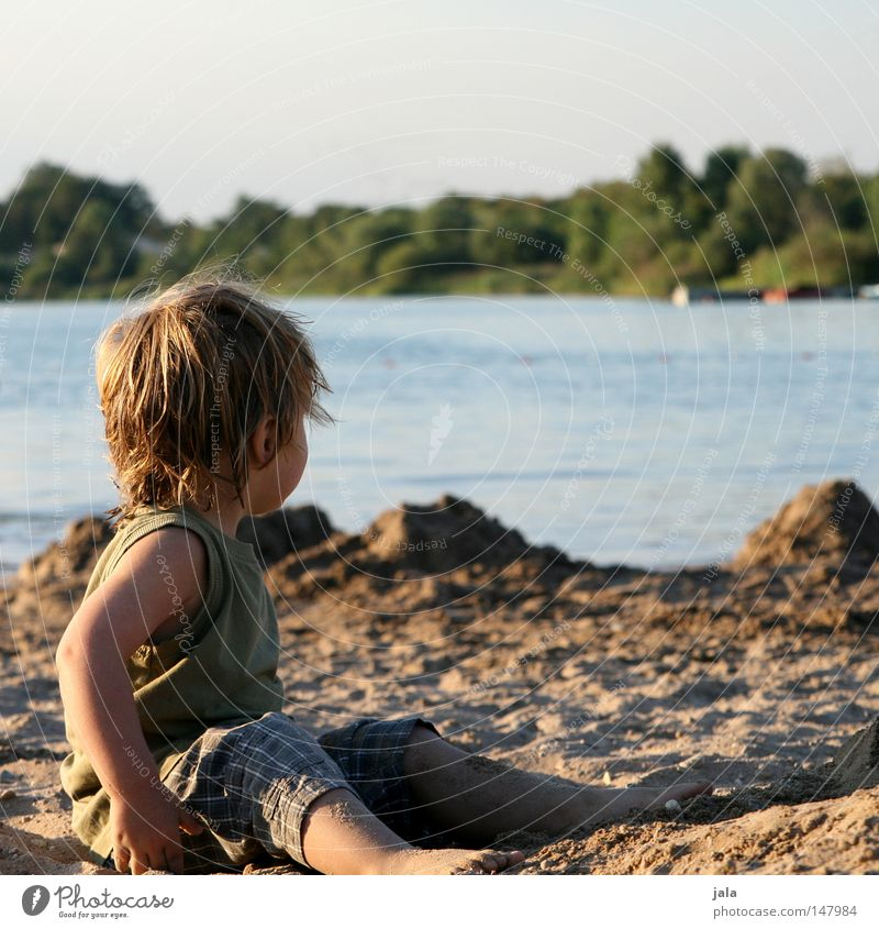 last day at the lake Looking Calm Lake Sand Boy (child) Water Sit Posture Weather Dream Longing Blonde Human being Vacation & Travel Leisure and hobbies Joy