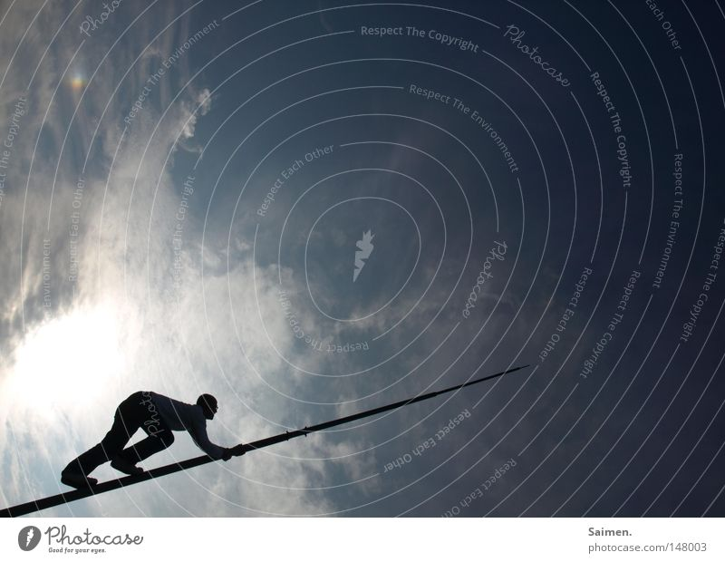 Walk The Line Sky Shadow Dark Bright Contrast Man Climbing Free-climbing Clouds Silhouette Flagpole Rod Thin Narrow Blue End Forwards Crooked Complex Brave