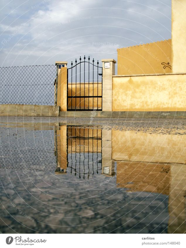Water Vacation & Travel House (Residential Structure) Wall (barrier) Rain Closed Living or residing Gate Spain Puddle Majorca Insolvency Symmetry Ambient